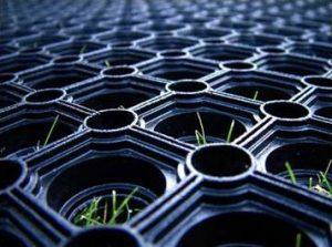 How do rubber grass mats work