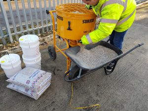 SoRoTo forced action mixer in use with wheelbarrow
