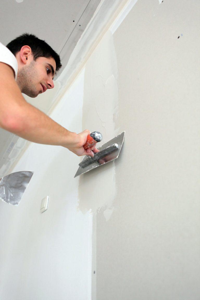 Man with plastering trowel