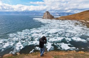 Climate changes rises temperatures which melts ice caps and causes surface flooding